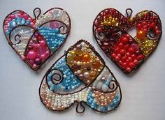 beaded pendants  http://make-handmade.blogspot.com/search/label/making%20flowers?updated-max=2011-08-09T21:33:00-07:00=20=70=false heart, pendant, melted beads, craft idea, seed beads, jewelry ideas, beaded jewelry, the wire, beaded ornaments
