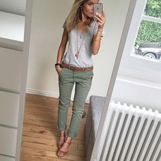 Green pants and white or gray shirt with leather sandals or wedges