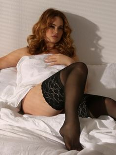"Plus Size Extra-Wide Lace Band Stay-Up Thigh Highs. These sexy thigh high stockings have an extra wide 5"" stretch lace band. Silicone backing lets you wear these stockings with or without garters."