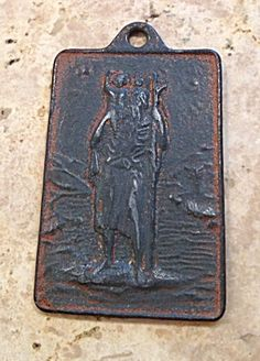 """Rare Catholic Medal! Back reads: Saint Christopher Protect Us. I believe this to be a late 1800's bronze holy medal.  The medal shows wear and has a nice heavy patina.  1.75"""" long."""