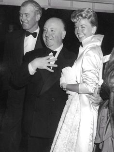James Stewart, Alfred Hitchcock, and Doris Day at the Hollywood premiere of their film The Man Who Knew Too Much, 1956