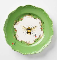 bee plate from anthro vintage plates, buzz, bee decor, bumble bees, anthropologie plates, honey bees, china, bumble bee dishes, bee plate