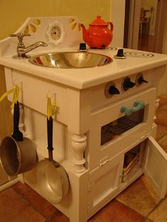 This is perfect for the kids and inexpensive! Thrifted DIY play kitchen. #goodwill