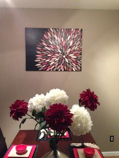 Canvas with scrapbook paper flower