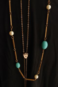 A gorgeous strand with vintage appeal. Faux Turquoise and Pearl Necklace. $49.00, via Etsy.