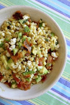 Bacon, Corn, and Avocado Salad: 5 strips bacon, fried. In bacon grease, brown 4 ears corn kernals (abt 2 c). Add 1/2c crumbled feta or cotija cheese, 2T fresh cilantro, juice of 1 lime. Add 1 chopped avocado and S to taste. Serve at room temp.