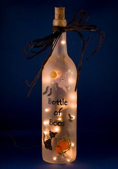 Halloween Lighted Bottle  Hand Painted Bottle of Boos Spooky Ghosts Flying Bats Recycled Wine Glass Accent Lamp Frosted Glass. $25.00, via Etsy.