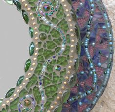 Round Mosaic Mirror in Greens and Gold. $120.00, via Etsy.
