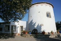 This beautifully restored and extended windmill in the hills above Faro has three bedrooms and two bathrooms. http://meravista.com/en/property-faro-algarve-portugal/house-estoi-18990