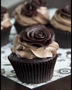 Chocolate cupcakes with moldering choc rose