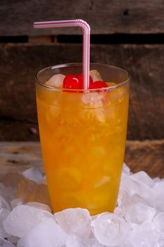 Peached Whale  The recipe:  1/2 ounce Malibu rum  1/2 ounce Bacardi rum  1/2 ounce peach schnapps  1/2 ounce amaretto  Fill passionfruit juice  Garnish with a cherry (or three!)