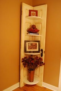 Old door cut in half and repurposed as a corner shelf!