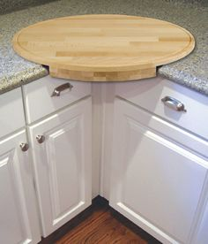 corner cutting board- you can put the trash can under it and sweep the scraps into it. This is cool!!