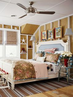 Get inspired by your favorite places when decorating your bedroom. Here, a bedroom uses a beach theme, with sand-colored walls and vintage-inspired fabrics, to create a soothing vibe. A blue upholstered headboard and blue trim on the bedspread adds a water-like hue to the palette. The beaded-board ceiling and grass-cloth walls add rustic texture to a room filled with beachside memories. Beach House, Beach Cottages, Cottages Bedrooms, Beach Bedrooms, Bedrooms Design, Beach Theme, Families Rooms, Guest Rooms, Bedrooms Decor
