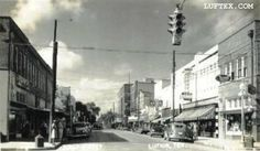 First Street Lufkin, 1940's.   Looking South. Perry Brothers on the right, as it looked before it was destroyed by fire about 1949.