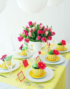A preppy mod baby shower in a sunny color palette of yellow, white and hot pink, featuring a Greek key pattern.  Party goods and styling by WH Hostess. Some nice ideas for a baby shower