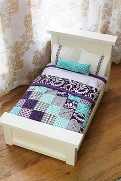 DIY Doll Beds and Tiny Quilts, nice! OK, I just might have to make one of these for my daughter's American Girl doll. :)