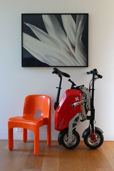 Folding electric bike by Voltitude, art by Martino Coppes, chair by Joe Colombo