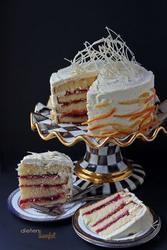 White Chocolate Cake and Frosting with Spiced Cranberry Puree and Sugared Citrus Peels. From