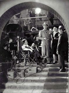 "Director William Wyler with Humphey Bogart, Claire Trevor and Allen Jenkins on the set of ""Dead End"" (1937)"