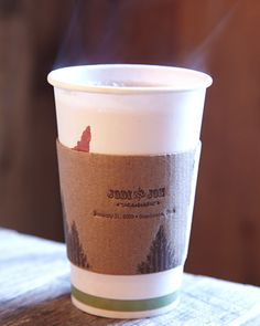 Serve hot chocolate and apple cider in customized cups to guests before a chilly wedding ceremony