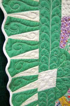 "close up, Dresden plate quilt border, in the ""Quilt as Desired"" exhibit by Mary Kerr.  Photo by Canton Village Quilt Works"