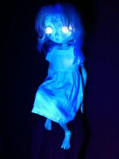 EZ ghost: spray paint a doll w/glow paint..great photos at the site!