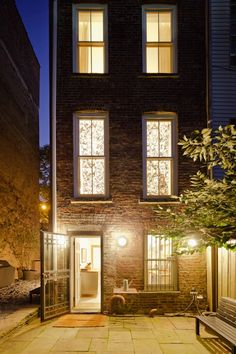 1880's renovated townhouse in Brooklyn, New York.  Three story brick house with patio garden.