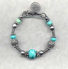 """""""Turquoise Sea"""" Lampwork and Sterling Silver Swirl Bracelet"""