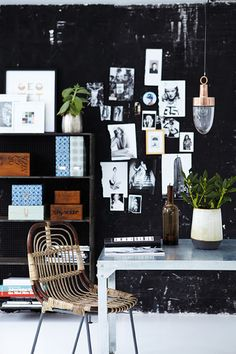 {black} walls makes a room go pop! - photos on wall, house doctor, anya adores, chair, table, bookcase, plant, brown bottle, decorative boxes -