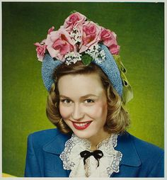 If you're going to do an Easter bonnet, do an Easter bonnet right (like this lovely 1940s gal). #Easter #vintage #1940s #hat #bonnet #fashion #clothes #forties #woman
