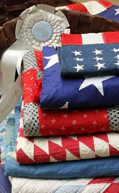 Red White and Blue flags with quilts...