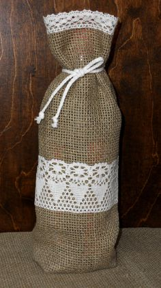 Wine bottle gift bag natural linen burlap with lace. $5.50, via Etsy.