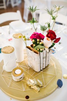 centerpieces with rolled birch, photo by Rachel Whyte http://ruffledblog.com/texas-gemstone-wedding #weddingideas #weddingcenterpiece