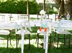 mr. + mrs. chair back signs // photo by Troy Grover Photographers, view more: http://ruffledblog.com/backyard-california-wedding/