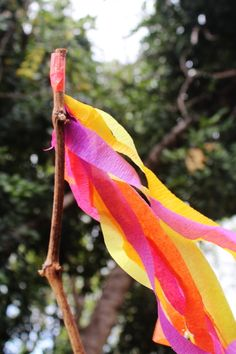 make pretty banners with sticks (bring strips of scrap cloth) for the beach or camping... kids nature craft activity