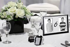 Feature photos of the bride and groom at various ages as the table markers. You can print the photos at Kodak Picture Kiosk. #wedding #photography #ideas #diy #craft