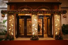 Entrance flower arch with backlit panels