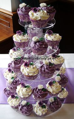 cream and purple cupcakes - http://www.weddingacrylics.co.uk/round-cupcake-stands/round-cup-cake-stand.html