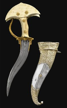 An ivory hilted dagger (Khanjarli) and silver scabbard, South India, early 18th century, the curved double edged watered steel blade chiseled with central ridge and yallis flanking the forte, curved steel knuckle guard terminating in a dragon's head, ivory hilt in four parts secured with gold rosette pins terminating in a bifurcated pommel, the silver scabbard engraved with designs of scrolling vegetation, birds and stylized flowers with bud finial. 37.3cm