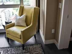 A cozy armchair, paired with a studded metal toss pillow, offers a personal corner to enjoy the view or relax with a good book.#HGTVUrbanOasis  http://www.hgtv.com/urban-oasis/hgtv-urban-oasis-2013-master-bedroom-pictures/pictures/page-4.html?soc=pinterest