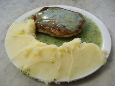 M. Manze Pie and Mash on Tower Bridge Road is the world's most famous pie-and-mash shop, and one of the most popular London attractions with those tourists looking to experience the taste of traditional working-class London. The shop serves traditionally-prepared pie and mash in liquor (parsley sauce) as well as jellied eels and stewed eels: the food of Cockneys.    Pie and mash, as well as jellied eels, are an iconic part of London's glorious history