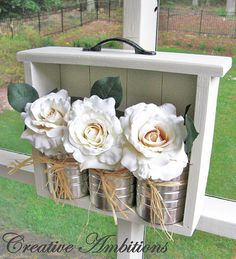 drawer hung on post w/ cans and flowers