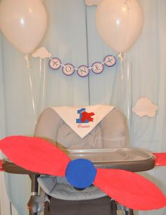 Airplane Highchair Decor for this Airplane 1st Birthday Party - too cute!