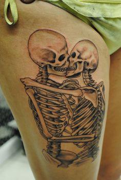 Kissing skeletons.