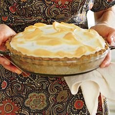 Butterscotch Meringue Pie with Pecan Crust | We won't revoke your pie credentials if you use a purchased piecrust in this recipe, but we love the way the homemade crust's earthy flavor elevates the caramel filling so much that we recommend you give it a try.