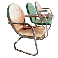 The front yard is just aching for a pair of these vintage metal tulip chairs