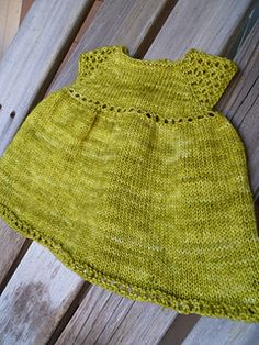 Camaron knit baby dress by Taiga Hilliard (top-down, seamless)