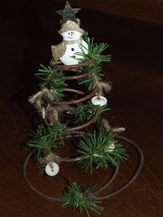 I think this is an old bed spring and it makes the best Charlie Brown Christmas tree.