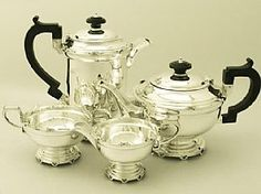 A fine and impressive vintage George VI English sterling silver four piece tea and coffee service in the Art Deco style; an addition to our ...